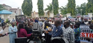 Protesters who stormed the entrance of the ruling All Progressives Congress (APC)